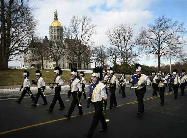 The Westhill High School Marching Band from Stamford marches past the State Capitol in the Inaugural Parade of new Connecticut Governor Dan Malloy in downtown Hartford on Wednesday, January 5, 2011. Photo: Brian A. Pounds / Connecticut Post