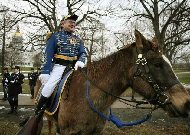 Governor's Horse Guard Major Gordon McNeil of Woodbury waits for the start of the Inaugural Parade for new Connecticut Governor Dan Malloy in downtown Hartford on Monday, January 5, 2011. Photo: Brian A. Pounds / Connecticut Post