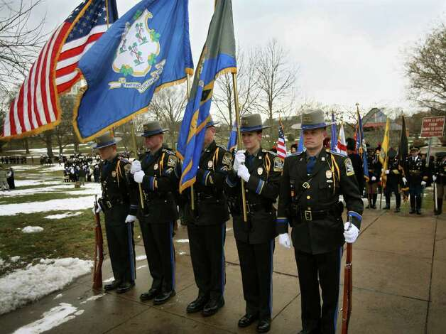 The Connectict State Police Honor Guard stand at attention as they wait to lead the Inaugural Parade of new Connecticut Governor Dan Malloy in downtown Hartford on Wednesday, January 5, 2011. Photo: Brian A. Pounds / Connecticut Post