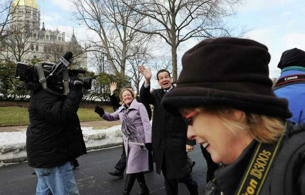 Governor-elect Dannel P. Malloy marches with his wife Cathy Malloy during the Inaugural parade along Capitol Ave. in Hartford, Conn. on Wednesday, January 5, 2011. Photo: Kathleen O'Rourke / Stamford Advocate