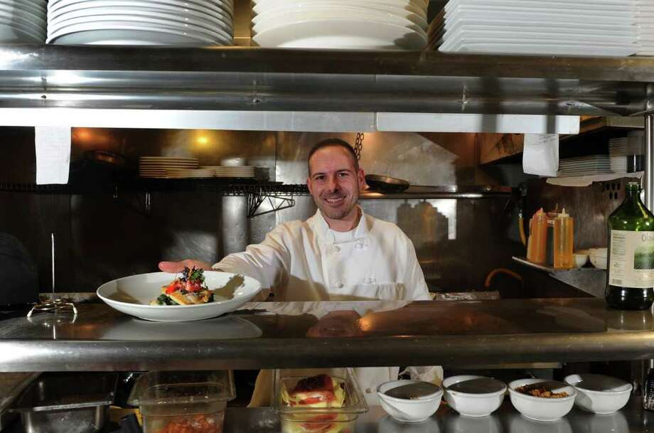 Chef Sam DeVellis poses in the kitchen of his restaurant Carl Anthony Trattoria in Monroe, Conn. on Wednesday January 5, 2011. Photo: Christian Abraham / Connecticut Post