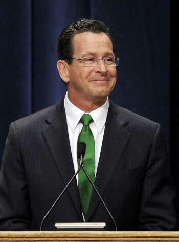 Gov. Dan Malloy smiles to the crowd after being sworn in as Connecticut's 88th governor inside the Hartford State Armory in Hartford Conn., Wednesday, Jan. 5, 2011. (AP Photo/Sean D. Elliot, Pool) Photo: AP