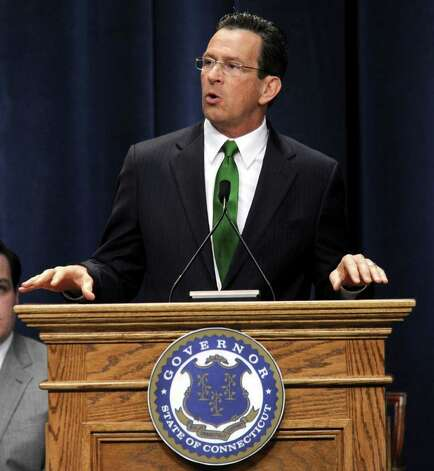 Gov. Dan Malloy speaks after being sworn in as Connecticut's 88th governor inside the Hartford State Armory in Hartford Conn., Wednesday, Jan. 5, 2011. (AP Photo/Sean D. Elliot, Pool) Photo: AP