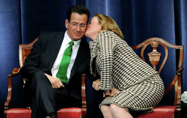 "Dan Malloy gets a kiss from his wife Cathy while ""Danny Boy"" is played during the ceremony to swear Malloy in as Connecticut's 88th governor inside the Hartford State Armory in Hartford Conn., Wednesday, Jan. 5, 2011.  (AP Photo/Sean D. Elliot, Pool) Photo: AP"