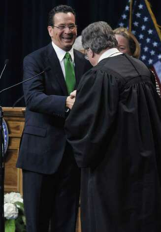 Dan Malloy is sworn in as Connecticut's 88th governor by the Honorable Gerald Fox inside the Hartford State Armory in Hartford Conn., Wednesday, Jan. 5, 2011. (AP Photo/Jessica Hill, Pool) Photo: AP