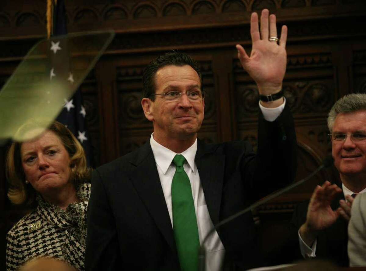 New Connecticut Governor Dannel Malloy waves as he prepares to address a joint session of the Connecticut General Assembly after his inauguration in Hartford on Wednesday, January 5, 2011.
