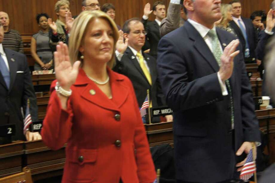 Brenda Kupchick takes her first oath of office as a state representative from Fairfield during swearing in ceremonies Wednesday at the state Capitol in Hartford. Photo: Paul Schott / Westport News
