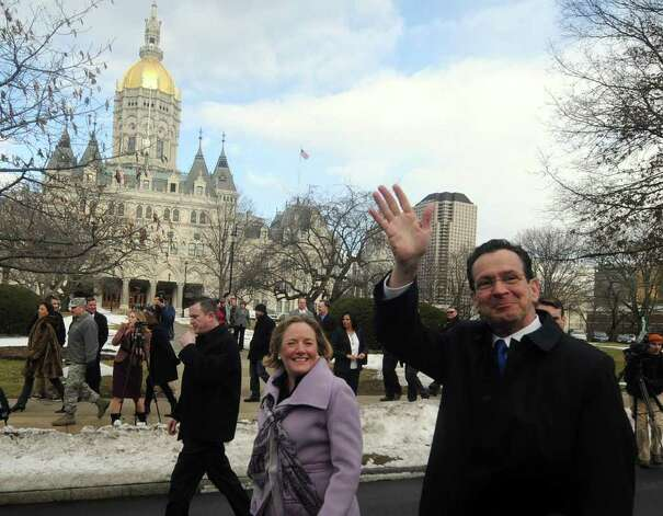 Connecticut Governor-elect Dan Malloy and wife Cathy march to the Connecticut State Armory for his inauguration ceremony passing by the Capitol building in Hartford, Wednesday, Jan. 5, 2011. (AP Photo/Journal Inquirer, Jim Michaud) Photo: AP