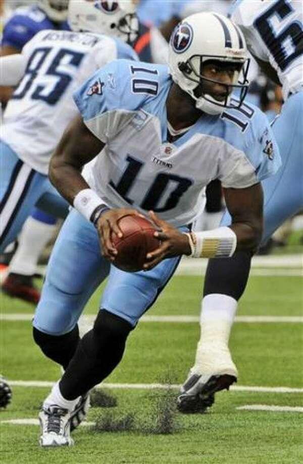 Titans quarterback Vince Young scrambles against the Giants on Sept. 26.