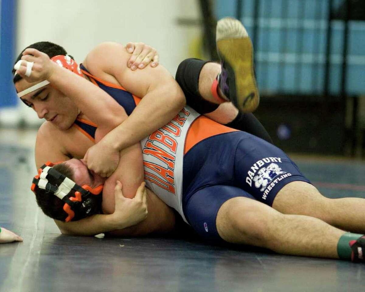 Danbury's Eddie Garcia (top) won by pin over Ridgefield's Nate Marsili in their 215-pound match Wednesday at Danbury High.