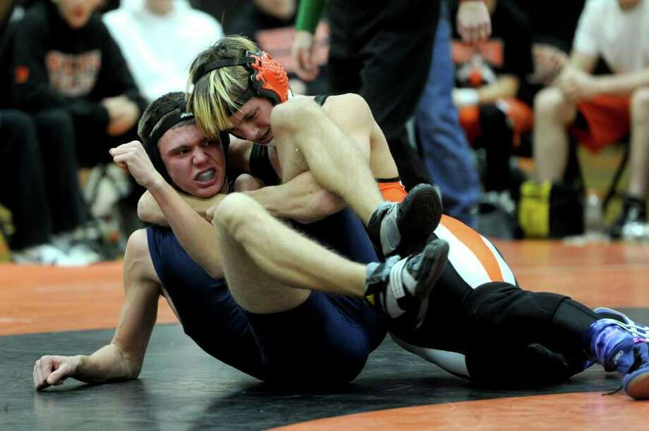 Anthony Riso of Foran, left, and Edward Hunt of Shelton, right, wrestle during Wednesday's match at Shelton High School on January 5, 2011. Photo: Lindsay Niegelberg / Connecticut Post