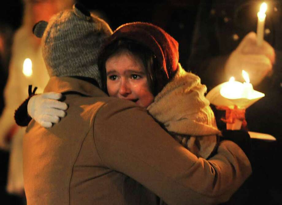 A group of 7th graders from Nicholas Naumkin's school hold a candlelight vigil and sing songs in his memory of him and his grandfather Oleg Moston in Congress Park in Saratoga Spings, NY on January 5, 2011.  Here, Angela Tucker, of Glens Falls, consoles her daughter Kaitlyn, 6. (Lori Van Buren / Times Union) Photo: Lori Van Buren