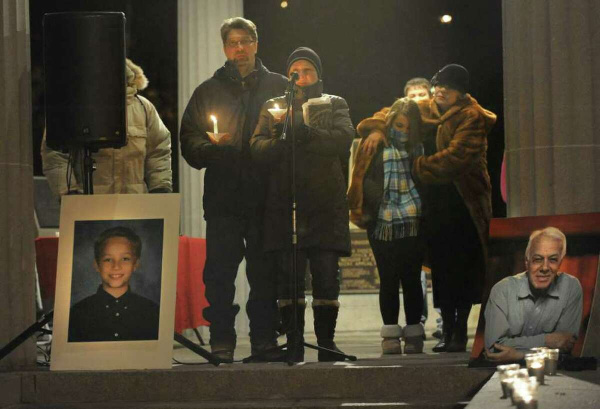 Seventh-graders from Nicholas Naumkin's school hold a candlelight vigil and sing songs in his memory of him and his grandfather Oleg Moston in Congress Park in Saratoga Spings on Jan. 5. Here, Yuri and Oksana Naumkin thank supporters for attending the vigil. (Lori Van Buren / Times Union