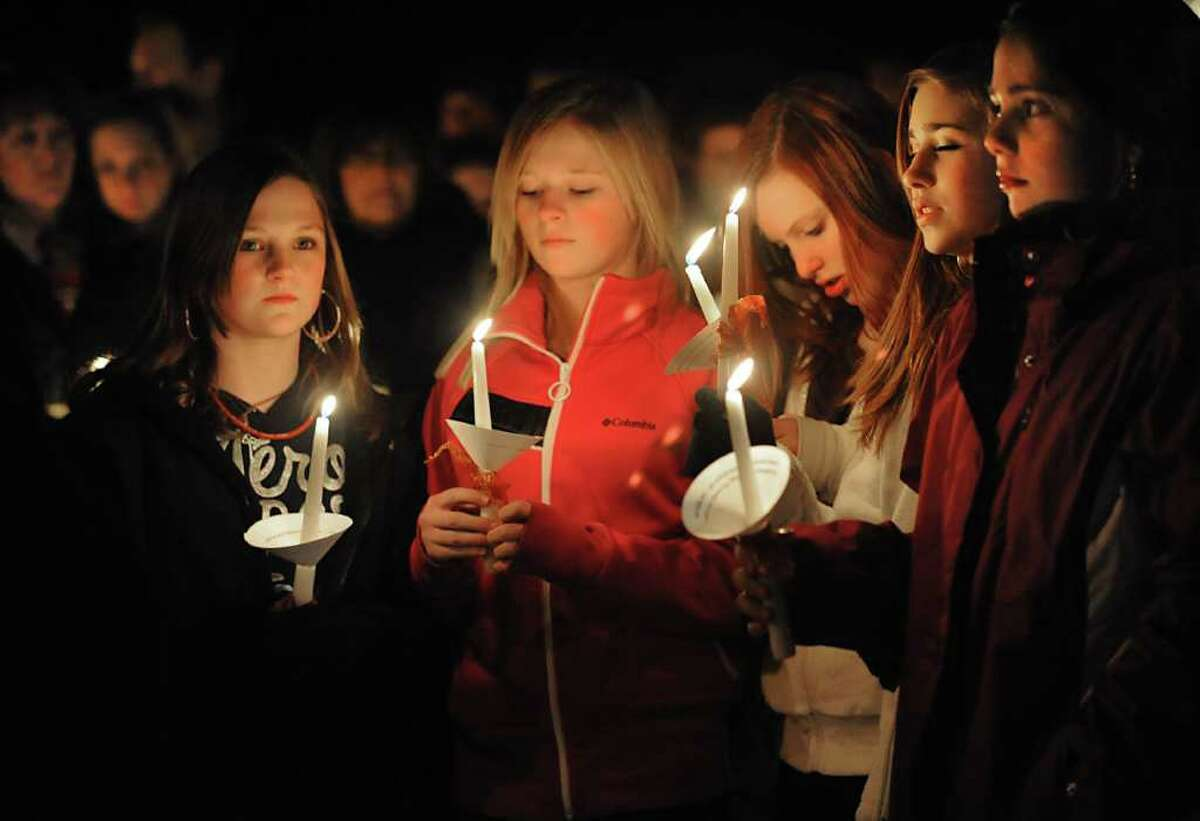 Seventh-graders from Nicholas Naumkin's school hold a candlelight vigil and sing songs in his memory of him and his grandfather Oleg Moston in Congress Park in Saratoga Spings. (Lori Van Buren / Times Union