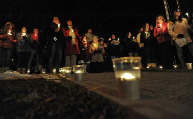 Seventh-graders from Nicholas Naumkin's school hold a candlelight vigil and sing songs in his memory of him and his grandfather Oleg Moston in Congress Park in Saratoga Spings on Jan. 5.  (Lori Van Buren / Times Union Photo: Lori Van Buren