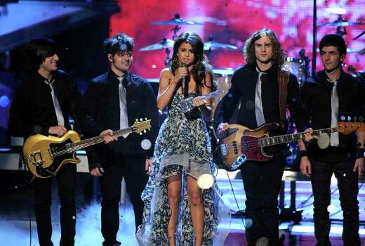 LOS ANGELES, CA - JANUARY 05:  Selena Gomez & the Scene accept the Favorite Breakout Artist award onstage during the 2011 People's Choice Awards at Nokia Theatre L.A. Live on January 5, 2011 in Los Angeles, California.  (Photo by Kevin Winter/Getty Images) *** Local Caption *** Selena Gomez Photo: Kevin Winter, Getty Images / 2011 Getty Images