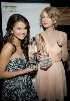 LOS ANGELES, CA - JANUARY 05:  Singer/actress Selena Gomez (L), winner of the Favorite Breakout Artist award and musician Taylor Swift, winner of the Favorite Country Artist award pose backstage at the 2011 People's Choice Awards at Nokia Theatre L.A. Live on January 5, 2011 in Los Angeles, California.  (Photo by Charley Gallay/Getty Images for PCA) *** Local Caption *** Selena Gomez;Taylor Swift Photo: Charley Gallay, Getty Images For PCA / 2011 Getty Images