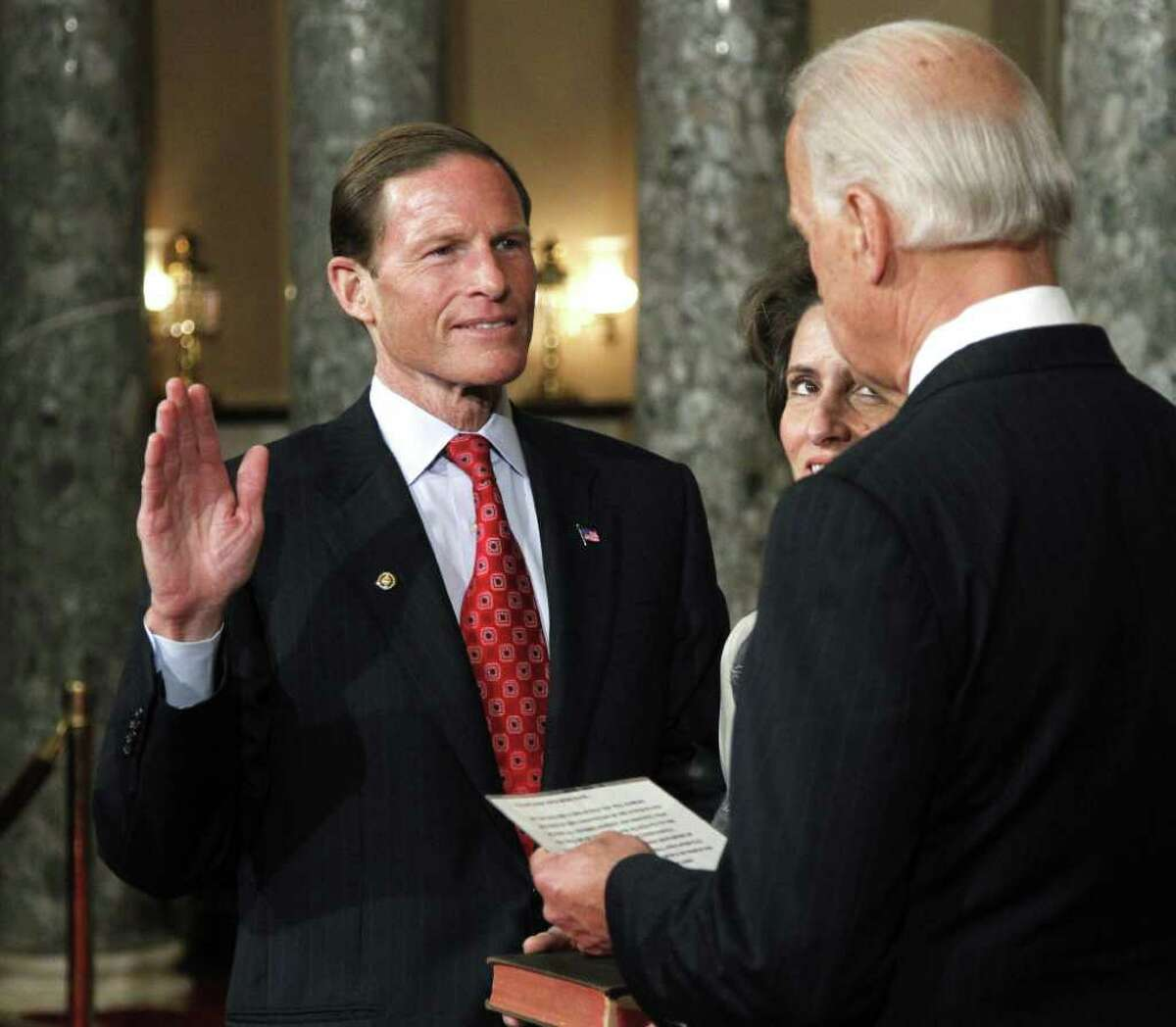Vice President Joe Biden administers a ceremonial Senate oath during a mock swearing-in ceremony to Sen. Richard Blumenthal, D-Conn., left, accompanied by his wife Cynthia, Wednesday, Jan. 5, 2011, in the Old Senate Chamber on Capitol Hill in Washington. (AP Photo/Manuel Balce Ceneta)