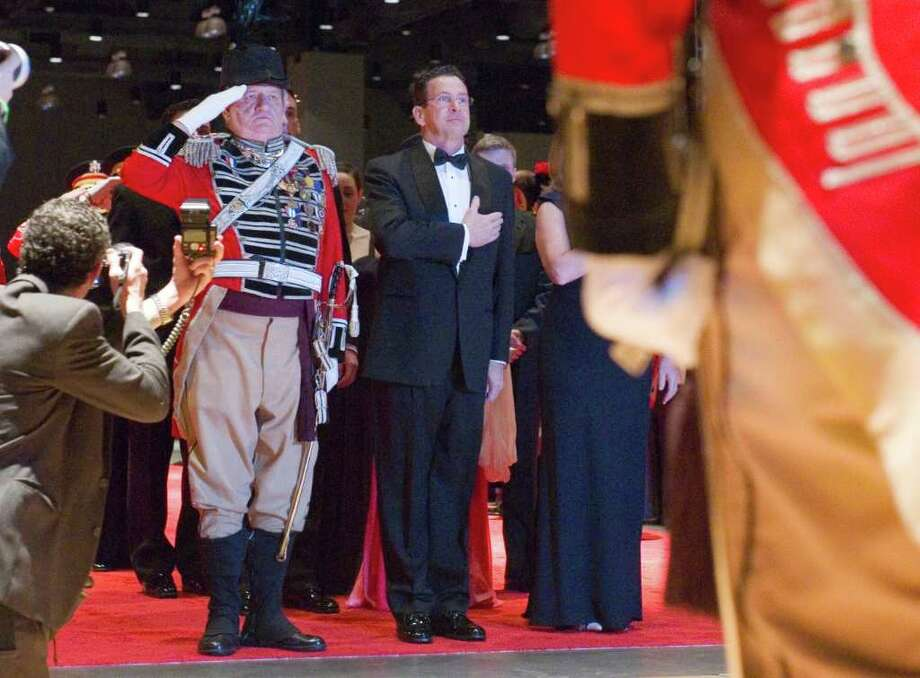 Connecticut's 88th Governor Dannel P. Malloy pauses for the Pledge of Allegiance as he arrives at the 2011 Inaugural Ball at the Connecticut Convention Center in Hartford, Conn., Wednesday evening, January 5, 2011. The ball is hosted by the Board of Trustees of the First Company Governor's Foot Guard. Photo: Keelin Daly / Stamford Advocate