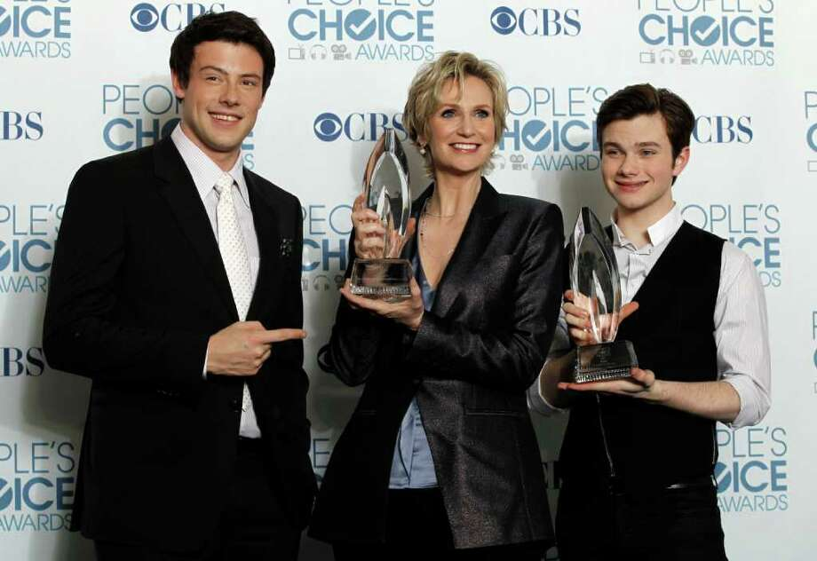 """From left, Cory Monteith, Jane Lynch, and Chris Colfer pose for a photo backstage with the award for favorite TV comedy for """"Glee"""" at the People's Choice Awards on Wednesday, Jan. 5, 2011, in Los Angeles. (AP Photo/Matt Sayles) Photo: Matt Sayles, STF"""