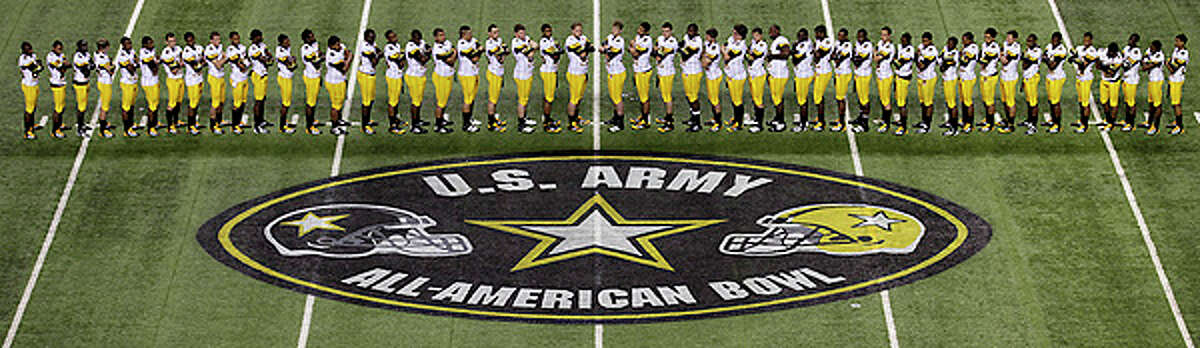 Members of the West Team line up for a photo during Photo Day for the U.S. Army All-American Bowl at The Alamodome, Wednesday.