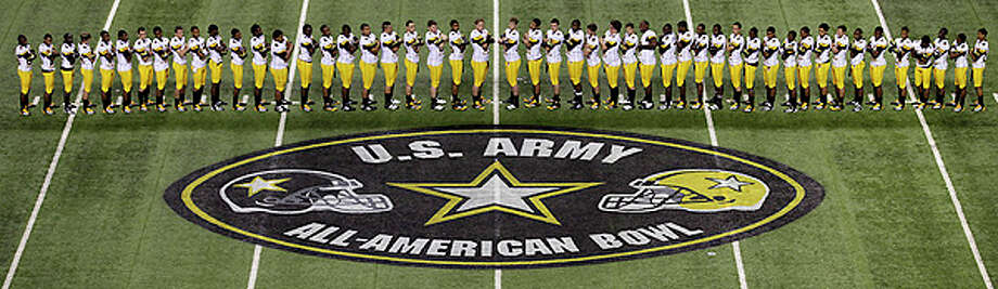 Members of the West Team line up for a photo during Photo Day for the U.S. Army All-American Bowl at The Alamodome, Wednesday. Photo: Bob Owen/rowen@express-news.net / SAN ANTONIO EXPRESS-NEWS