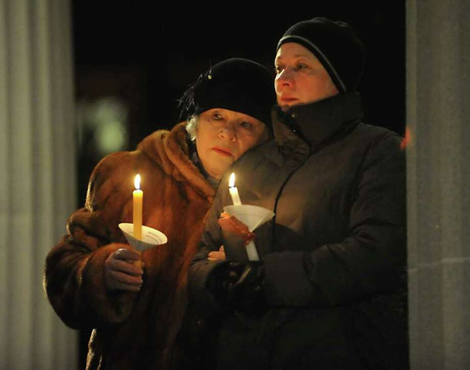 A group of 7th graders from Nicholas Naumkin's school hold a candlelight vigil and sing songs in his memory of him and his grandfather Oleg Moston in Congress Park in Saratoga Spings, NY on January 5, 2011.  Here Oleg's wife Nina Moston, left, and Nicholas' mother Oxsana Naumkin hold candles during the vigil. (Lori Van Buren / Times Union) Photo: Lori Van Buren