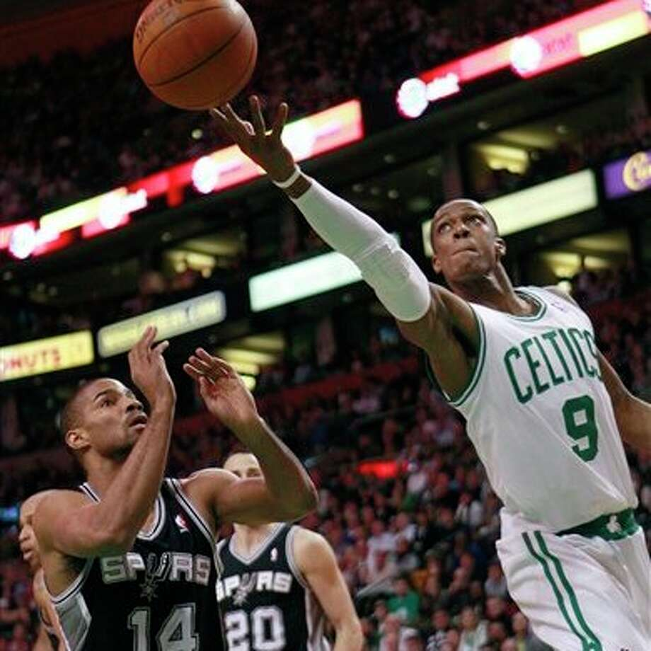Celtics guard Rajon Rondo goes in for a shot against the Spurs. Photo: Associated Press