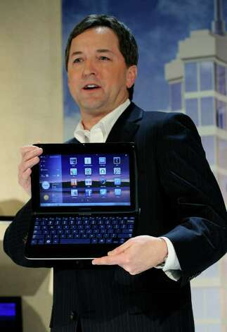 LAS VEGAS, NV - JANUARY 05:  Samsung Electronics America's Vice President of Enterprise Business Division Doug Albregts displays the Samsung 7 Series Sliding PC featuring a keyboard that slides out of a tablet design during a press event at the 2011 International Consumer Electronics Show at the Venetian January 5, 2011 in Las Vegas, Nevada. CES, the world's largest annual consumer technology tradeshow, runs from January 6-9 and is expected to feature 2,700 exhibitors showing off their latest products and services to about 126,000 attendees.  (Photo by Ethan Miller/Getty Images) Photo: Ethan Miller