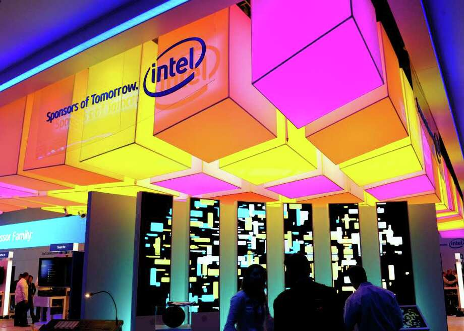 Workers set up the Intel display at the 2011 International Consumer Electronics Show January 5, 2011 in Las Vegas, Nevada.  CES, the world's largest annual consumer technology tradeshow, officially runs from January 6-9.  AFP PHOTO  / Robyn Beck (Photo credit should read ROBYN BECK/AFP/Getty Images) Photo: ROBYN BECK