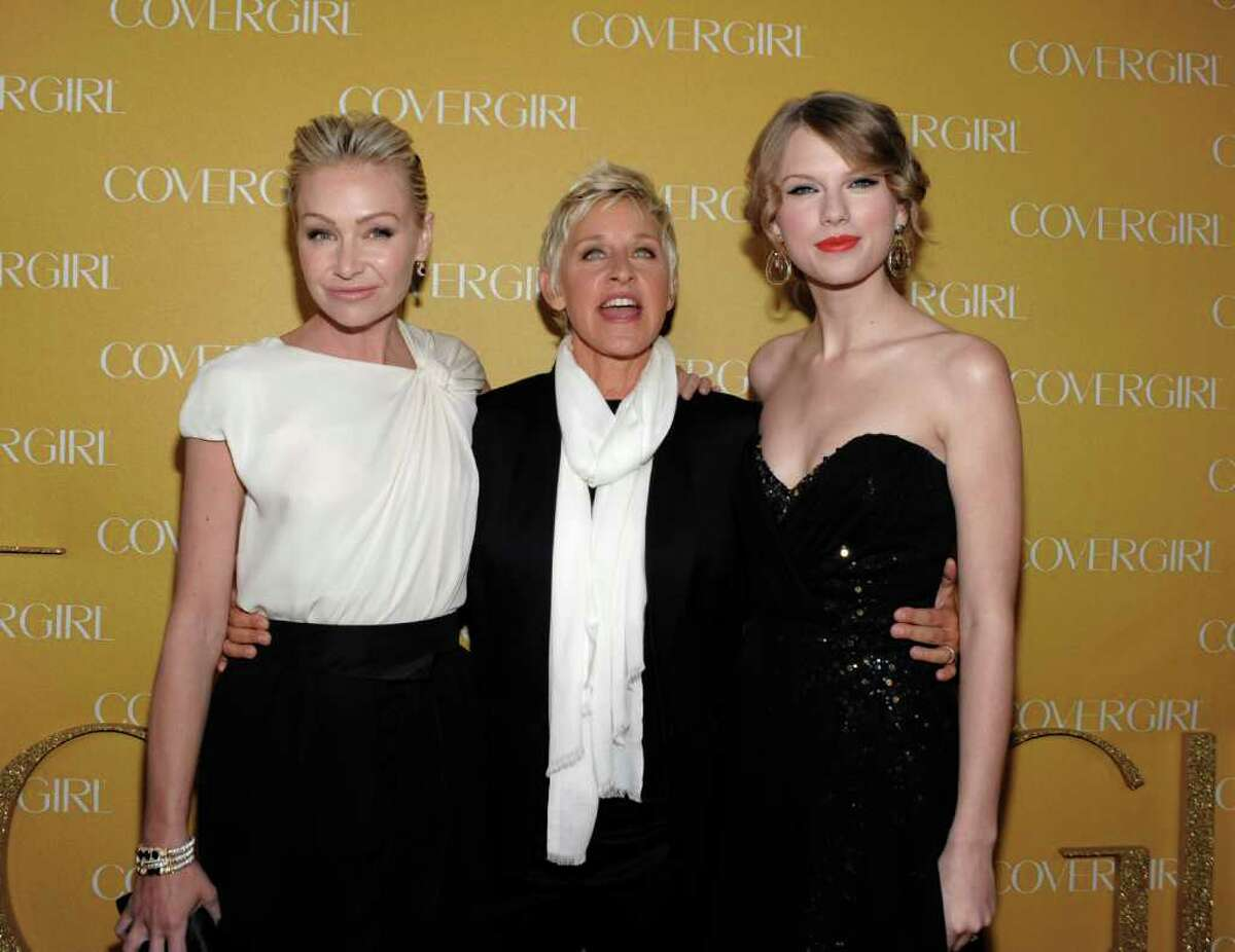 Actress Portia de Rossi, left, television personality Ellen DeGeneres, center, and singer Taylor Swift arrive at the COVERGIRL Cosmetics' 50th Anniversary Party in Los Angeles on Wednesday, Jan. 5, 2011. (AP Photo/Dan Steinberg)