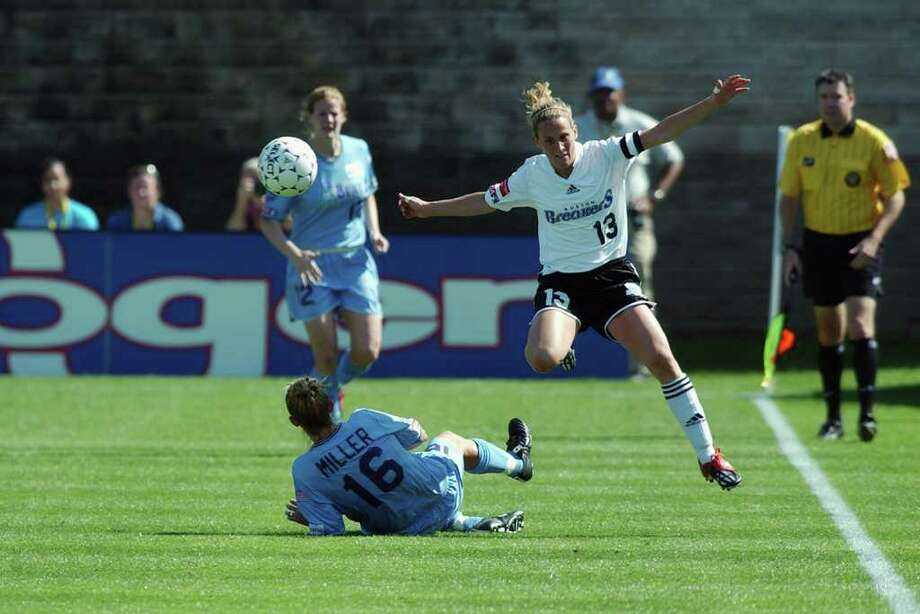 ATLANTA - APRIL 12:  Midfielder Marci Miller #16 of the Atlanta Beat breaks up a play by midfielder Kristine Lilly #13 of the Boston Breakers during the WUSA game at Herndon Stadium on April 12, 2003 in Atlanta, Georgia. The Beat defeated the Breakers 6-0.  (Photo by Erik S. Lesser/Getty Images) Photo: Erik S. Lesser, Getty Images / 2003 Getty Images