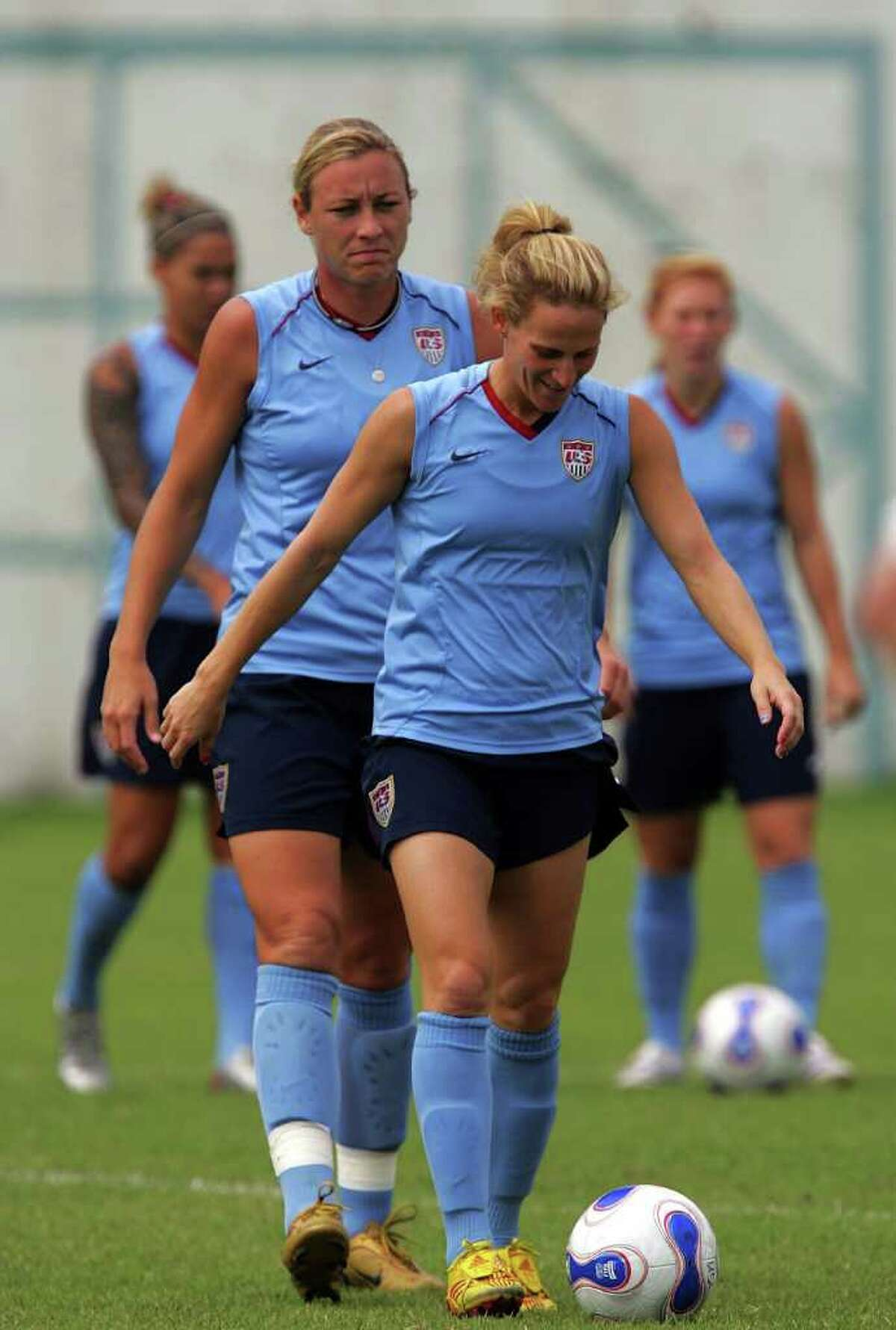 SHANGHAI, CHINA - SEPTEMBER 25: Midfielder Kristine Lilly of USA controls the bal in front of Abby Wambach during a United States of America training session for the FIFA Women's World Cup at Shanghai Senshua FC on September 25, 2007 in Shanghai, China. (Photo by Ronald Martinez/Getty Images) *** Local Caption *** Kristine Lilly;Abby Wambach