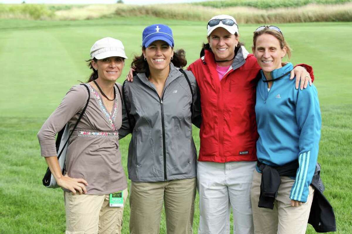 SUGAR GROVE, IL - AUGUST 21: US Soccer stars (left to right) Mia Hann, Julie Foudy, Carla Overbeck and Kristine Lilly attending the matches during the Friday afternoon foursome matches at the 2009 Solheim Cup Matches, at the Rich Harvest Farms Golf Club on August 21, 2009 in Sugar Grove, Ilinois (Photo by David Cannon/Getty Images) *** Local Caption *** Mia Hann;Julie Foudy;Carla Overbeck;Kristine Lilly