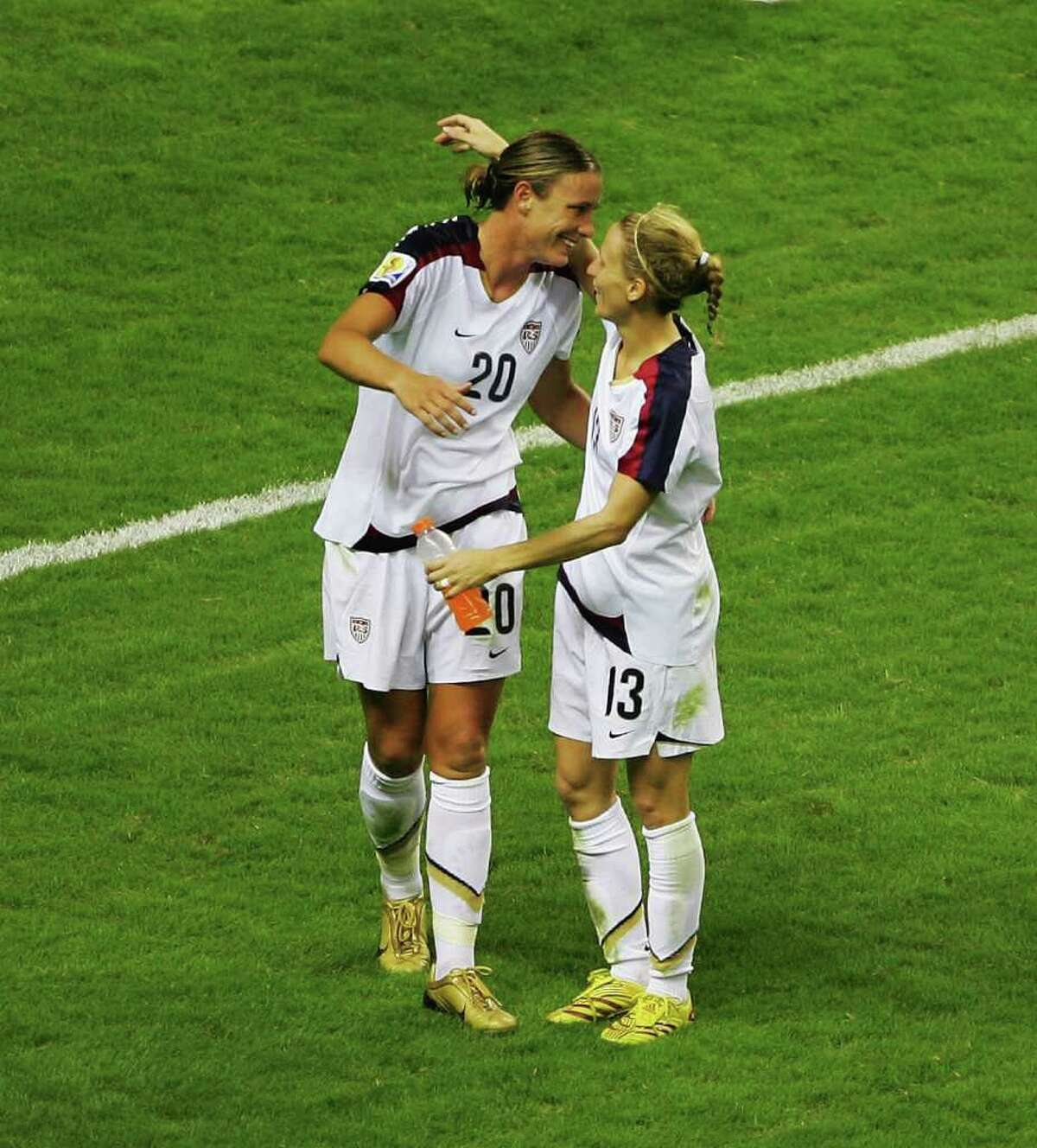 SHANGHAI, CHINA - SEPTEMBER 30: Abby Wambach (L) of USA celebrates with teammate Kristine Lilly after winning 4-1 the Women's World Cup 2007 3rd place play off match against Norway at Hongkou Stadium on September 30, 2007 in Shanghai, China. (Photo by Guang Niu/Getty Images) *** Local Caption *** Abby Wambach;Kristine Lilly