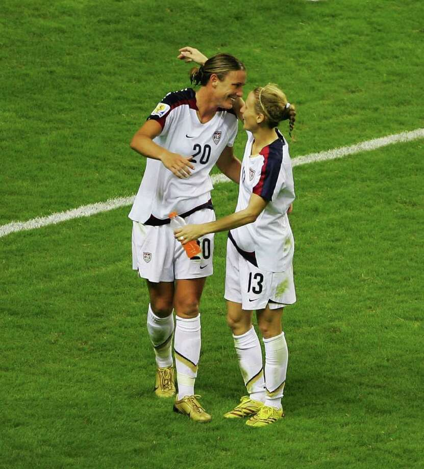 SHANGHAI, CHINA - SEPTEMBER 30:  Abby Wambach (L) of USA celebrates with teammate Kristine Lilly after winning 4-1 the Women's World Cup 2007 3rd place play off match against Norway at Hongkou Stadium on September 30, 2007 in Shanghai, China.  (Photo by Guang Niu/Getty Images) *** Local Caption *** Abby Wambach;Kristine Lilly Photo: Guang Niu, Getty Images / 2007 Getty Images