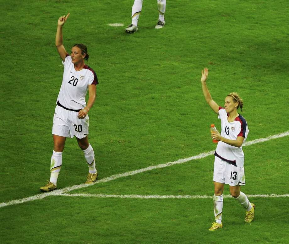 SHANGHAI, CHINA - SEPTEMBER 30:  Abby Wambach (L) and Kristine Lilly (R) of USA wave to crowd after their 4-1 win of the Women's World Cup 2007 3rd place play off match against Norway at Hongkou Stadium on September 30, 2007 in Shanghai, China.  (Photo by Guang Niu/Getty Images) *** Local Caption *** Abby Wambach;Kristine Lilly Photo: Guang Niu, Getty Images / 2007 Getty Images
