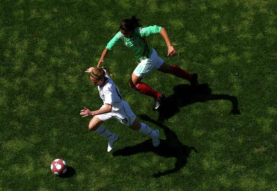 SAN DIEGO - MARCH 28:  Midfielder Kristine Lilly #13 of the USA controls the ball in front of Nayeli Rangel #11 of Mexico during the Women's International Friendly Soccer Match between Mexico and the United States at Torero Stadium on March 28, 2010 in San Diego, California. USA won 3-0. (Photo by Donald Miralle/Getty Images) *** Local Caption *** Nayeli Rangel;Kristine Lilly Photo: Donald Miralle, Getty Images / 2010 Getty Images