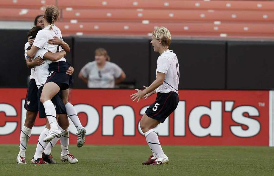 CLEVELAND - MAY 22:  Shannon Boxx #7, Kristine Lilly #13, and Lori Lindsey #5 of the United States celebrate after a goal against Germany during the game on May 22, 2010 at Browns Stadium in Cleveland, Ohio.  (Photo by Jared Wickerham/Getty Images) *** Local Caption *** Shannon Boxx;Kristine Lilly;Lori Lindsey Photo: Jared Wickerham, Getty Images / 2010 Getty Images