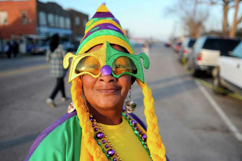 Sue James of Mamou, LA walks along Procter Street in downtown Port Arthur before the start of the  Mardi Gras celebration with the Majestic Krewe of Aurora Grand Parade. Saturday, February 13, 2010. Valentino Mauricio/The Enterprise Photo: Valentino Mauricio / Beaumont