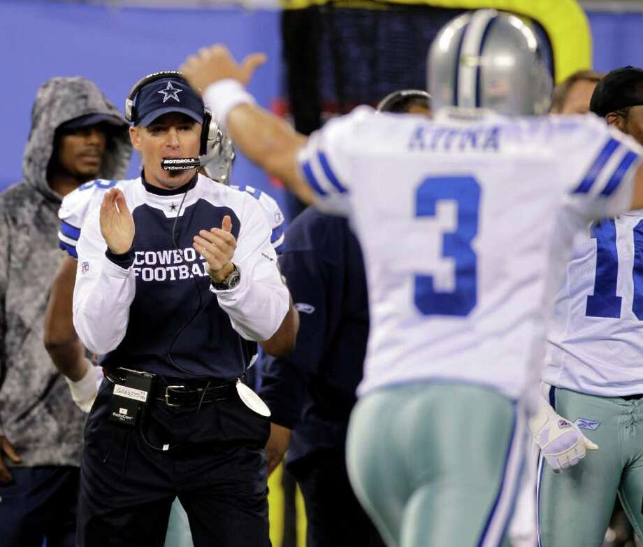 Dallas Cowboys interim coach Jason Garrett and quarterback Jon Kitna (3) react during the second quarter of an NFL football game against the New York Giants at New Meadowlands Stadium Sunday, Nov. 14, 2010, in East Rutherford, N.J.  (AP Photo/Seth Wenig) Photo: Seth Wenig / DirectToArchive