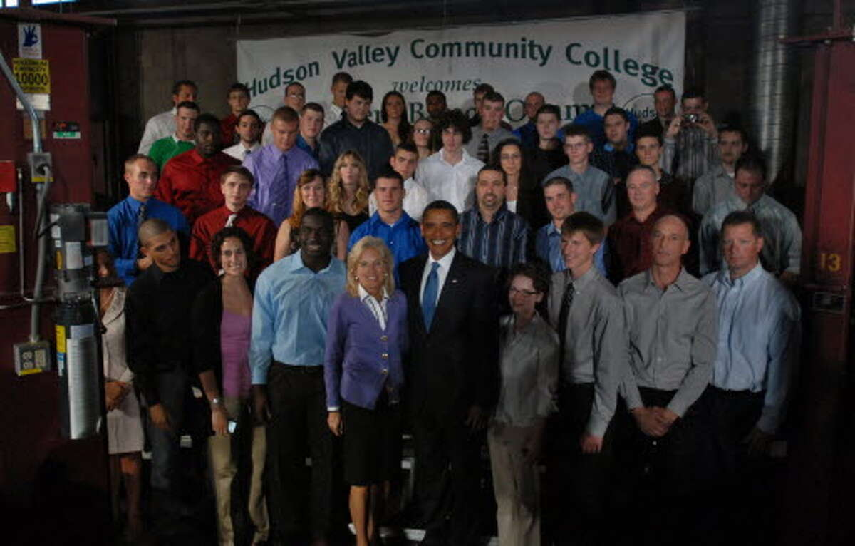 President Obama and Jill Biden, wife of Vice President Joseph Biden, pose for a group photograph with HVCC students following his speech at Hudson Valley Community College in Troy, NY on Monday September 21, 2009. (Philip Kamrass / Times Union)