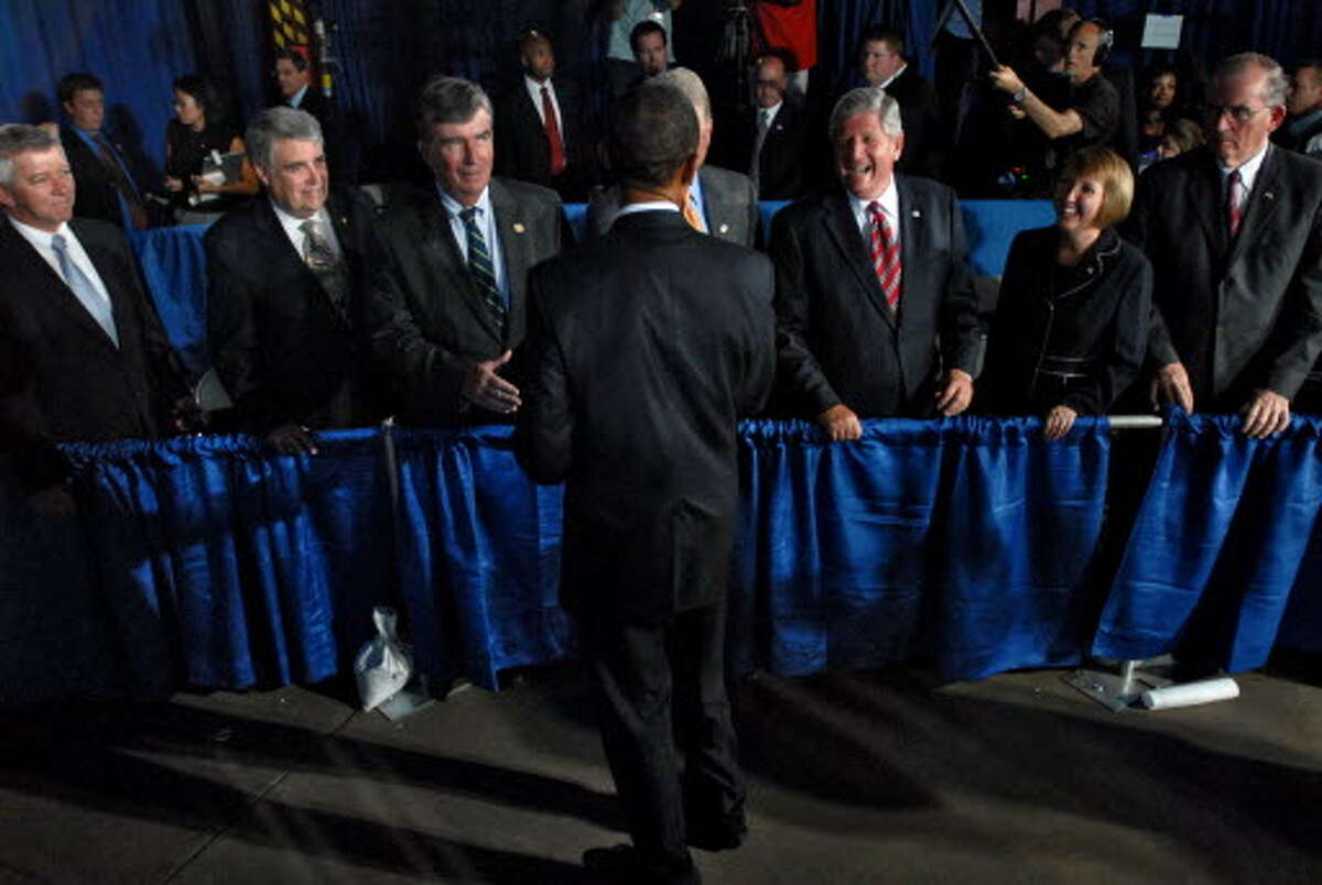President Obama greets Capital Region politicians following his speech at Hudson Valley Community College in Troy on September 21, 2009. From left to right are Assemblymen Kevin Cahill, John McEneny, State senators Neil Breslin and Roy McDonald, Rensselaer County Executive Kathy Jimino, and Albany County Executive Michael Breslin. Obscured behind the President is Schenectady Mayor Brian Stratton. (Philip Kamrass / Times Union)