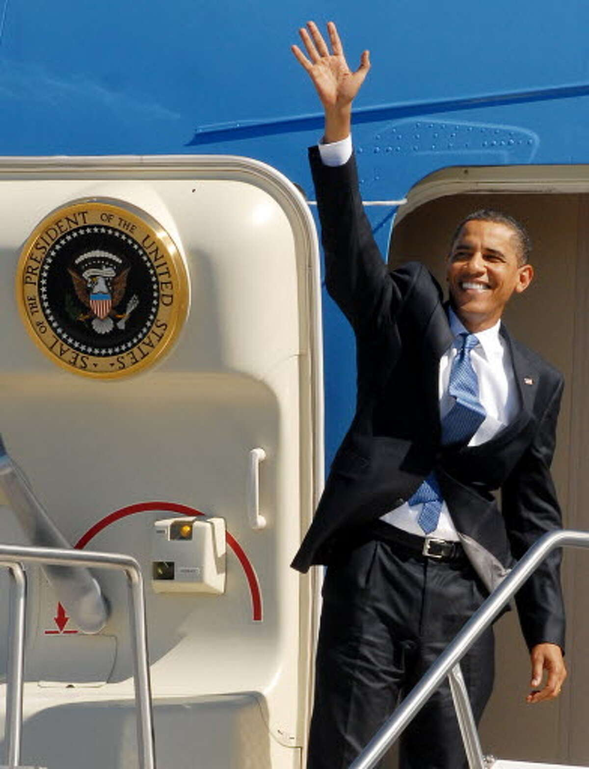 President Barack Obama turns to wave as he returns to Air Force One for departure at the Albany International Airport on Monday, Sept 21, 2009, after his tour and speech at Hudson Valley Community College. (Luanne M. Ferris / Times Union)