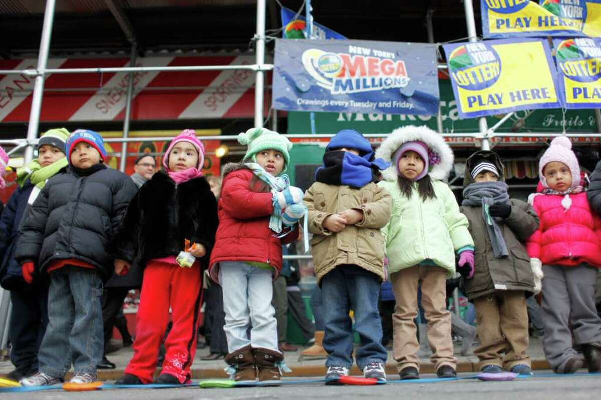 Preschool children from the Susan Patricof Head Start program watch El Museo del Barrio's 34th annual Three Kings Day parade, Thursday, Jan. 6, 2011, in New York.