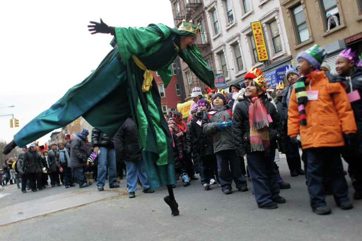 Michael McGuigan, left, as one of the kings, plays with the children during El Museo del Barrio's 34th annual Three Kings Day parade, Thursday, Jan. 6, 2011 in New York. The Three Kings Day Parade is an annual celebration in New York City that commemorates the most festive day of the winter season in Latin American culture. The celebration is designed to pay tribute to the day that the three kings came to visit baby Jesus.