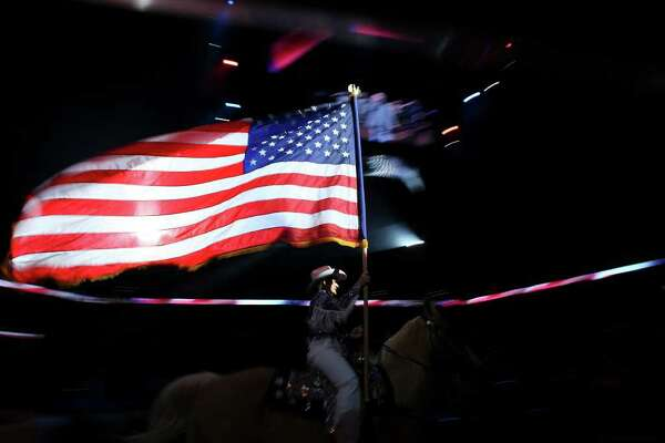 Brenda Harris of the Jack Sellers Bexar County Palomino Patrol presents the American flag during the grand entry at the San Antonio Stock Show & Rodeo Friday Feb. 12, 2010 in the AT&T Center.