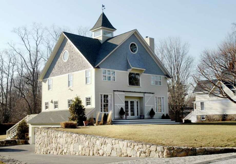 The Shippan home of Gov. Dannel Malloy and his wife Cathy could be put on the market soon as the couple looks to settle in to the Governor's Residence in Hartford. Photo: File Photo / Stamford Advocate File Photo