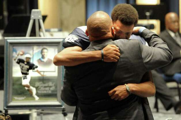 Mark Roberts hugs Reggie Garrett Sr. during the funeral services of star West Orange-Stark quarterback, Reggie Garrett Jr. in Orange, TX, Saturday, September 25, 2010. Tammy McKinley/The Enterprise Photo: TAMMY MCKINLEY, MBR / Beaumont