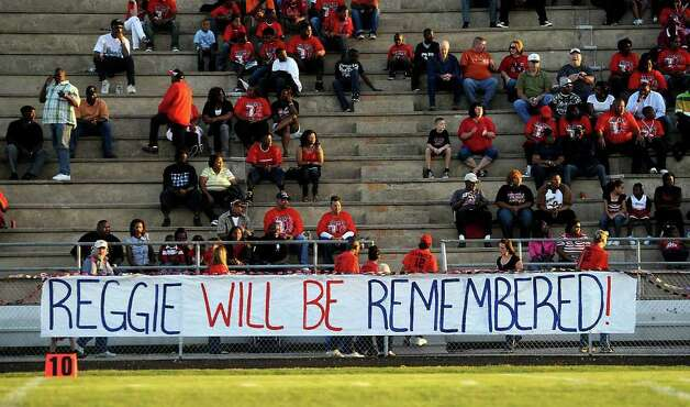 A banner on the Kirbyville side honors fallen WO-S fallen quarterback, Reggie Garrett, Jr. at West Orange-Stark High School in West Orange, Saturday. Tammy McKinley/The Enterprise Photo: TAMMY MCKINLEY, MBR / Beaumont